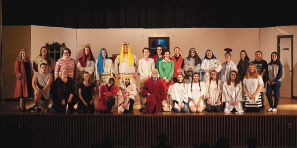 "The Gloversville High School's drama club, Scitamard, is presenting ""The Best Christmas Pageant Ever"" under the direction of Jennifer Flynn and technical director Marc Norton. A beloved classic since its original publication in 1972, this story is still appealing today. ""The Best Christmas Pageant Ever"" is sweet, humorous, and sentimental. The Herdmans are a family of children who swear, lie, and are generally feared by other kids. When they get wind of the annual church Christmas pageant, they bully their way into the main roles and wreak havoc. Through what is a most unusual Christmas pageant, the community takes another look at the Christmas story's true meaning. What some feared would be the worst pageant in church history turns out to have a special quality that causes the community to rethink the real meaning of the Christmas story. Show dates are Friday at 7 p.m. and Saturday at 2 and 7 p.m. Tickets are $4 for students and seniors, $7 for adults, and younger than five get in for free. (Photo courtesy of Sara Baldwin)"