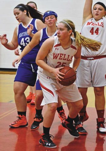 Wells' Joy Trezise (25) grabs a rebound in front of Northville's Catherine Millington (43) during Thursday's non-league game at Wells Central School. (The Leader-Herald/Bill Trojan)