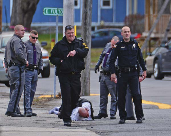 Law enforcement surround Mike Urbanski after a car chase in Johnstown Saturday afternoon. New York State Police, Johnstown and Gloversville police and Fulton County Sheriff deputies responded. (The Leader-Herald/Bill Trojan)