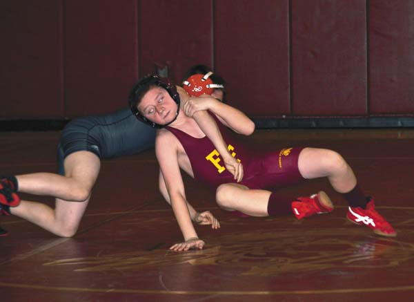 Fonda-Fultonville's Justin Kearns, right, looks for an escape during his 99-pound match with Albany Academy's Caleb Svingala on Jan. 14. Kearns is one of several returning wrestlers for the Braves this season. (The Leader-Herald/Paul Wager)
