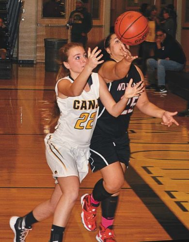 Canajoharie's Alexz Lathers (22) and Oppenheim-Ephratah/St. Johnsville's Merari Freeman (25) hustle after a loose ball off a rebound during the first half of Monday's Western Athletic Conference game at Canajoharie High School. (The Leader-Herald/James A. Ellis)