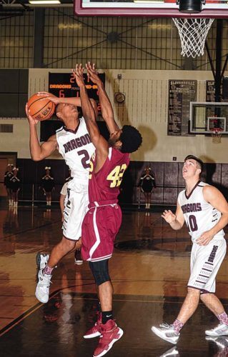 Gloversville's Josh Nails (2) is challenged by Notre Dame-Bishop Gibbons' Zyir Beverly (42) as he puts back an offensive rebound during Tuesday's non-league game at Gloversville High School. (The Leader-Herald/James A. Ellis)