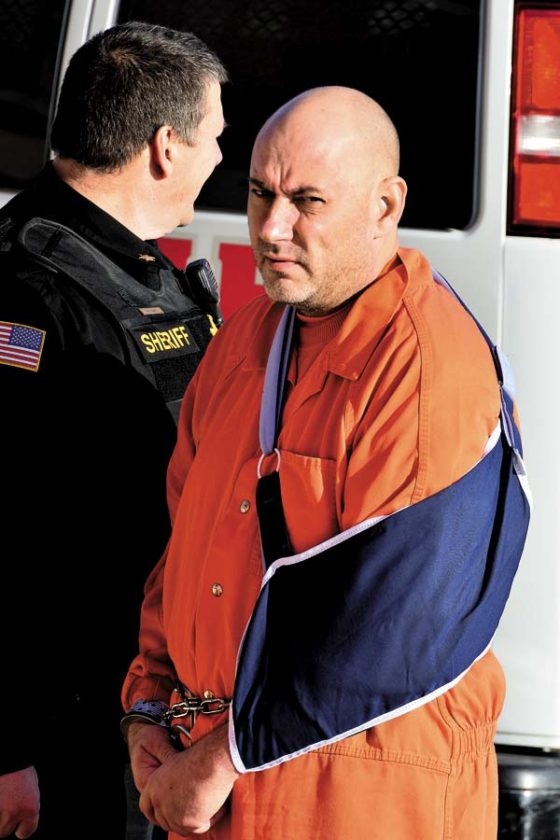 Michael Urbanski is escorted from a corrections van into City Court in Johnstown for his appearance Tuesday. He is being held on $50,000 bail, $100,000 bond. (The Leader-Herald/Bill Trojan)