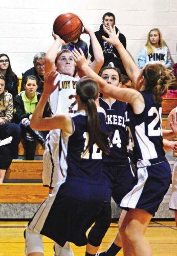 Fonda-Fultonville's Julianna Taylor (2) shoots over Mekeel Christian Academy's Rebekkah Dean (12), Madison Show (14) and Lillian Ballard (20) during Wednesday's game. (The Leader-Herald/Bill Trojan)