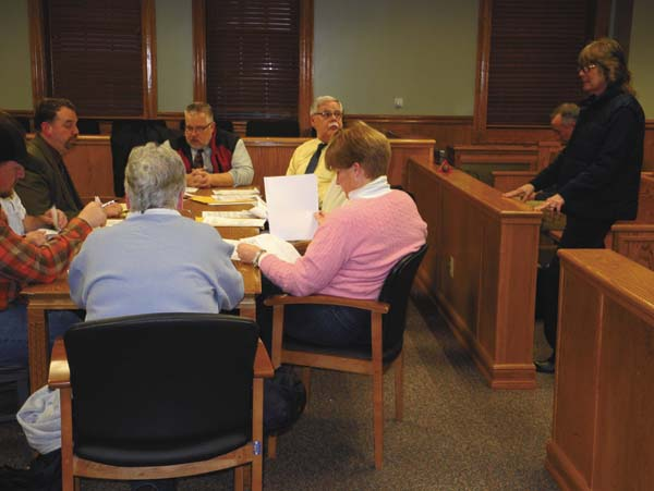 Carol Harper, standing at right, submits her request to operate a used car lot on Route 30A, at the Johnstown City Planning Board meeting Tuesday at City Hall. (The Leader-Herald/Michael Anich)