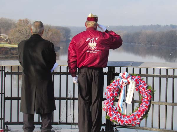 Jessica Bogdan Edward Russo and Robert Von Hasseln face the river as Taps plays in the background, honoring those who gave their lives. (Photo by The Leader-Herald/Opal)