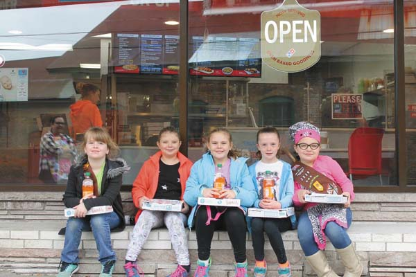 Five members of Brownie Girl Scout Troop 2536 recently visited the Gloversville Domino's Pizza and learned what it takes to run a pizza shop. Shown, from left,  are Annabelle Case, Sydney Rulison, Jorja Perron, Karyssa Hope and Nora Meyer. The troop is part of Girl Scout Service Unit 205 and consists of seven girls, all from Boulevard Elementary School, Gloversville. (Photo submitted)