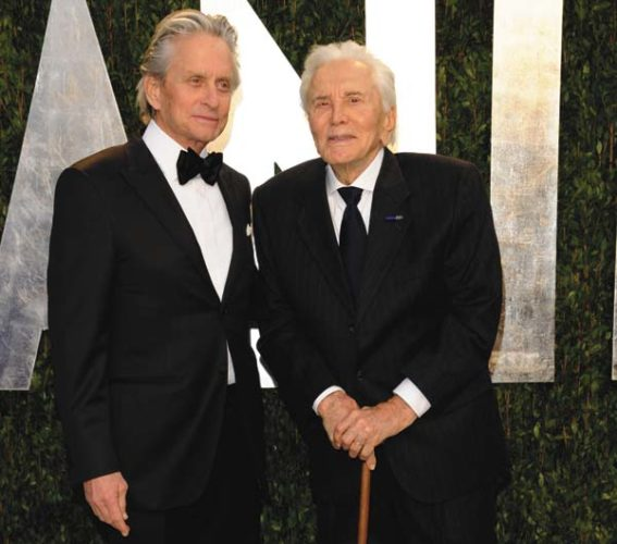 In this Feb. 26, 2012 photo, Michael Douglas, left, and Kirk Douglas arrive at the Vanity Fair Oscar party in West Hollywood, Calif.