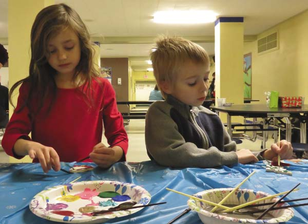 Siblings Leanora and Quinton Fitzgerald took great care in painting their ornaments at the Northville Santa breakfast. (Photo submitted)