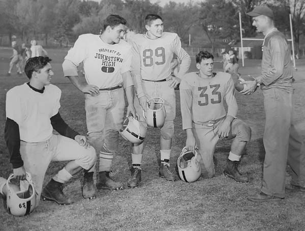 Former Johnstown football coach John Siedlecki, right, talks with players. (Photo submitted)
