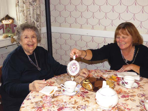 Resident Jean Loveday, left,  enjoys a cup of tea and cookies with  Board member Doreen Ford at a recent tea held at Willing Helpers Home for Women. (Photo courtesy of Tammy Kruger)