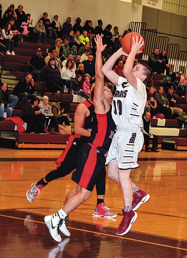 Glens Falls' Aaron Sampson (4) pressures Gloversville's Dante Bouchard (00) as he goes up for a shot during Foothills Council action Tuesday at Gloversville High School. (The Leader-Herald/James A. Ellis)