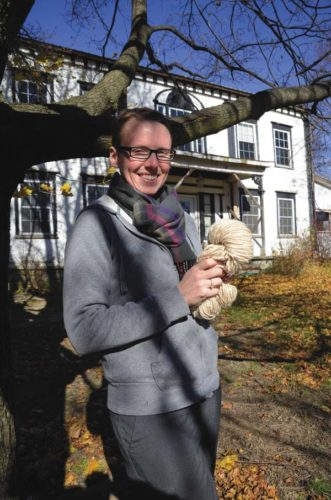 Samantha Graves poses with a skeen of handspun yarn. Graves is opening a co-op fiber mill. (Photo submitted)