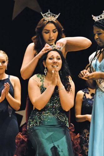 Miss Fulton County 2016 Lexi Swatt places the crown on Miss Fulton County 2017 Heather Graves at the conclusion of the pageant. This was Graves sixth and last opportunity to win the title. She also was awarded Miss Congeniality. (The Leader-Herald/Bill Trojan)
