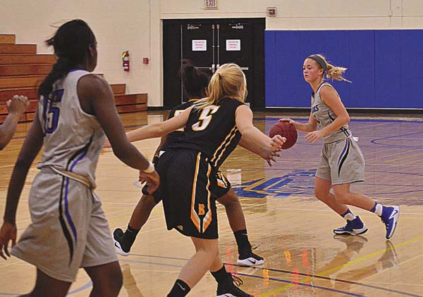 Mayfield graduate Julie Hampton (1) sets up a play for Fulton-Montgomery Community College in their game against SUNY Broome at FMCC. The Lady Raiders won 92-44. (The Leader-Herald/James A. Ellis)