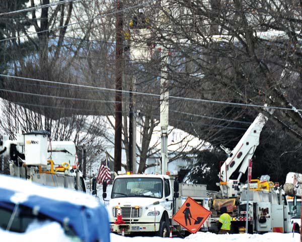 A lineman works on wires on Baker Road in Gloversville on Tuesday. (The Leader-Herald/Bill Trojan)