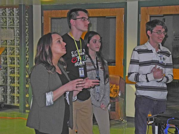 Left to right, Greater Johnstown School District technology teacher Rachel Heroth, and students Jack Truckenmiller, Bailey King and Jesse Ferri give a presentation on the Tech-Know program to the Board of Education Thursday night at Johnstown High School. (The Leader-Herald/Michael Anich)