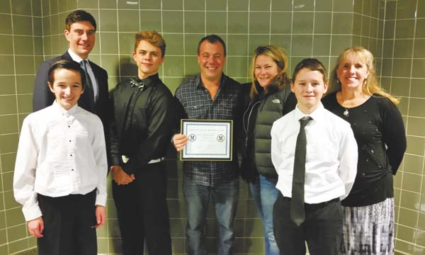 Shown, from left, at a recent Mayfield School District gathering are seventh-grader Britain Goodemote; high school Principal Christopher Wojeski; junior Ethan Gallup; Lou and Nancy Stutzke, of Fuel-N-Food; seventh-grader Hunter Jones; and Sandra Brower, a member of the leadership board of Academy of Character Education at Russell Sage College in Troy. Lou holds a certificate of appreciation from the academy. (Photo submitted)