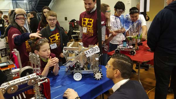 Fonda-Fultonville Robotics Club members talk about their robot with Assemblyman Angelo Santabarbara. (Photo submitted)