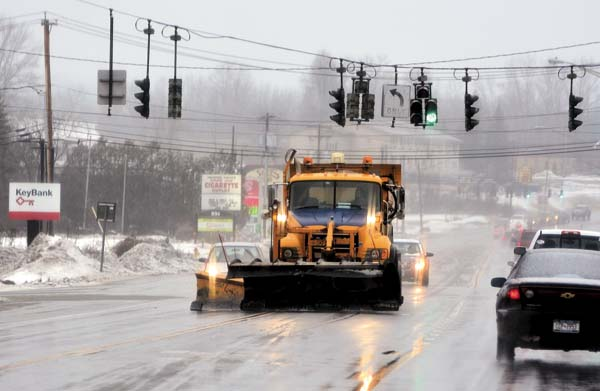 A state Department of Transportation plow truck scrapes North Comrie Avenue Wednesday in Johnstown. (The Leader-Herald/Bill Trojan)