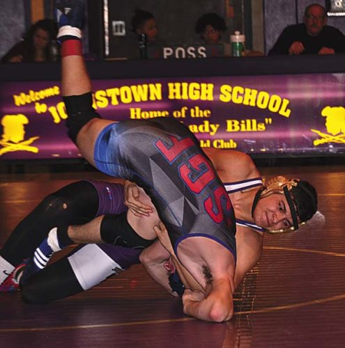 Johnstown's Brandon Crisafulli, right, turns South Glens Falls' Adam Basile during their 160-pound bout during Wednesday's Foothills Council wrestling match at Johnstown High School. (The Leader-Herald/Paul Wager)