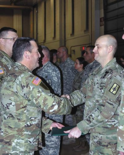 New York Army National Guard Chief Warrant Officer 2 Scott Walker receives his commendation medal on Jan. 7. (Photo submitted)