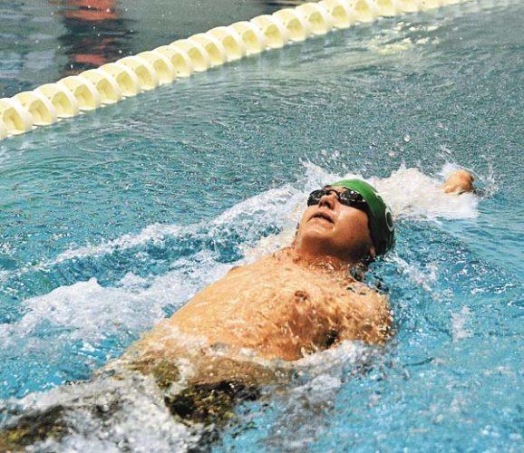 Fonda-Johnstown's Derek Lee swims the backstroke Thursday at Johnstown High School. (The Leader-Herald/Bill Trojan)