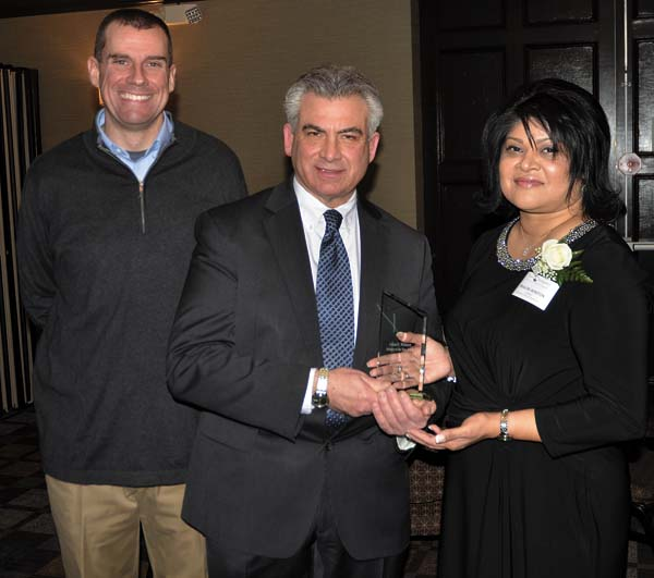 From left, Chamber Chair of the Board Paul Connelle, Fulton Montgomery Chamber President Mark Kilmer, and Executive Director Shaloni Winston, recipient of the Edward L. Wilkinson Industry of the Year of The Lexington Center and the Paul Nigra Center for Creative Arts. (The Leader-Herald/Bill Trojan)