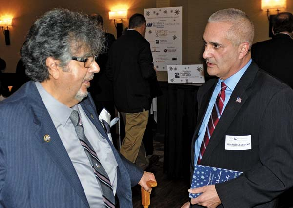 Maurice Farhart, left, of Gloversville and Fulton County Sheriff Richard Giardino socialize during the 2017 Celebration and Cocktail Party at the Johnstown Holiday Inn on Friday. (The Leader-Herald/Bill Trojan)