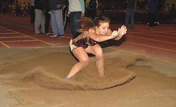 Fonda-Fultonville's Emma Rhodes lands in the pit in the long jump Saturday at Union College in Schenectady. Rhodes won the event with a leap of 14-6. (The Leader-Herald/James A. Ellis)