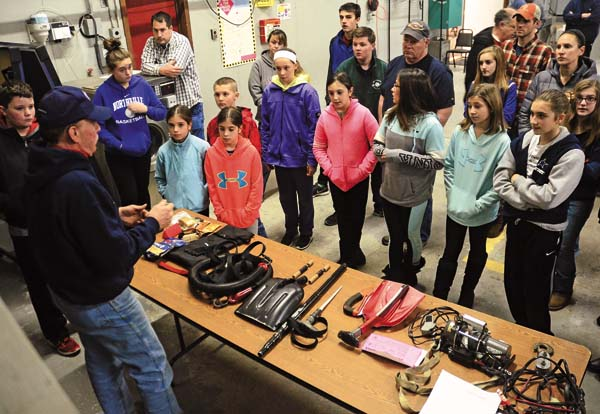 Glenn S. Hayton, New York State Snowmobile Association Schoharie director, instructs a group of students about tools of safety during a snowmobile class at the Mayfield Volunteer Fire Department in Mayfield on Saturday. (The Leader-Herald/Bill Trojan)