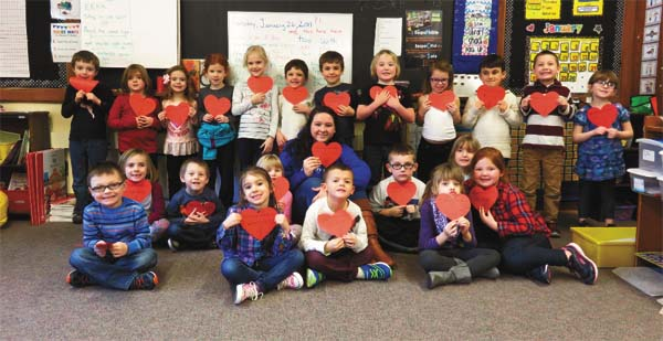 Each kindergarten student in the Northville Central School District was recently able to buy a heart in support of the Albany-area Ronald McDonald Houses. NCS high school students in the Community Leadership and Service class are running a Help with All Your Heart campaign, selling $1 and $5 hearts to raise money and collecting hygiene products in boxes throughout the school to donate to the houses.Pictured above, campaign organizer Catherine Millington, a student in Northville's Community Leadership and Service class, is surrounded by the kindergarten students who were able to purchase a heart for the Ronald McDonald House thanks to a donation from a parent. (Photo submitted)
