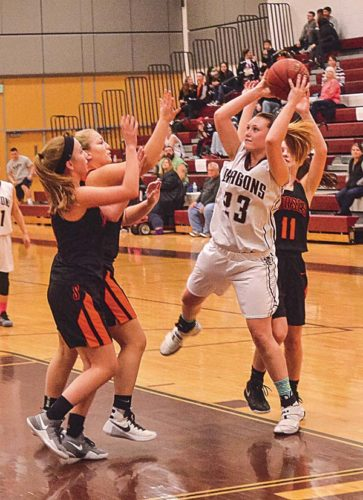 Gloversville's Kendra Lavery (23) grabs a rebounds as she is surrounded by Schuylerville's Cassie Patrick, Devynn Hough and Alison Burnham (11) during Monday's Foothills Council game at Gloversville High School. (The Leader-Herald/James A. Ellis)