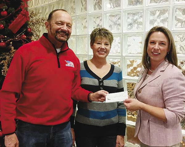 Doreen and Wayne Wnuk present a check for $1,000 to St. Mary's Foundation Executive Director Jessica Smrtic, right, to support St. Mary's Cancer Screening Program. (Photo submitted)