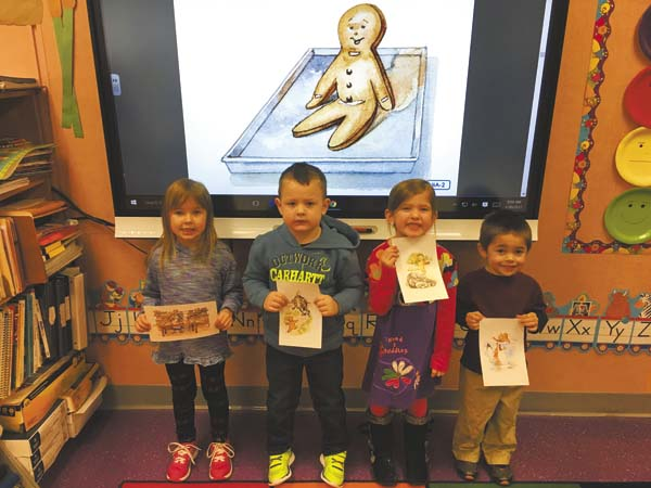 "After listening to ""The Gingerbread Man,"" Herkimer-Fulton-Hamilton-Otsego BOCES pre-kindergarten students Kara Rutherford, Paxson Dommer, Adrianna Santucci and Caleb Coffin, at West Canada Valley, retold the story and then decorated and ate their own gingerbread-man cookies.  (Photo submitted)"