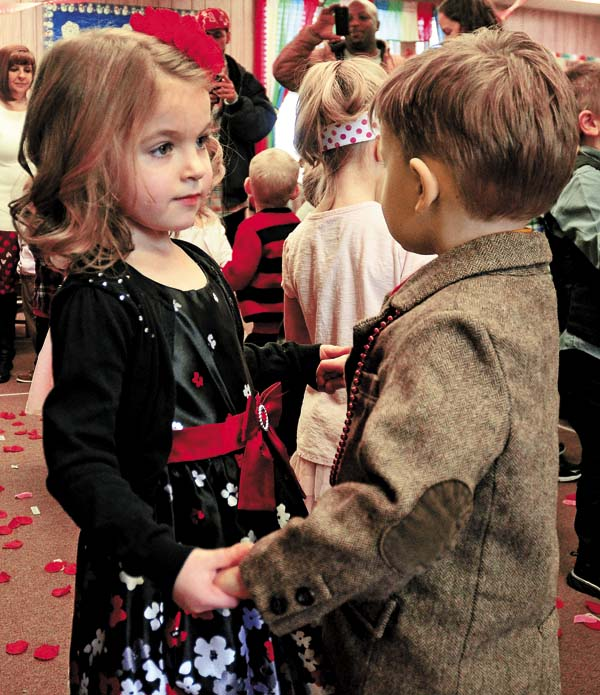 Luciana Hallenbeck, left, dances with Sawyer Huckans during the annual Valentine's Day Ball at the Rainbow Play School in Gloversville on Valentine's Day. (The Leader-Herald/Bill Trojan )