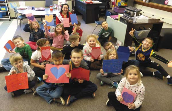 Heather Graves, Miss Fulton County 2017, poses with Northville first graders and the Valentine's Day cards she helped them make for sick children and their families. Graves will deliver Northville's cards, along with many others from around the region, to the Albany-area Ronald McDonald Houses today. (Photo submitted)