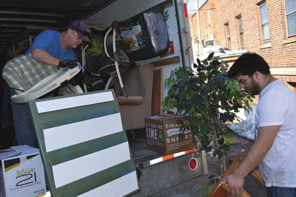 Dave Morrison of Broadalbin, left, and Chris Tylee of Gloversville unload furniture for Fulmont Community Church's new location in Gloversville. )The Leader-Herald/Eric Retzlaff)