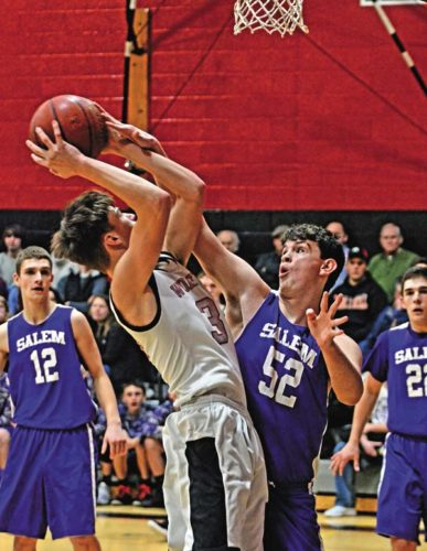 Oppenheim-Ephratah/St. Johnsville's Tyler Leon, left, looks to shoot as Salem's Matt Braymer defends during Tuesday's Section II Class D first-round game.  (The Leader-Herald/Bill Trojan)