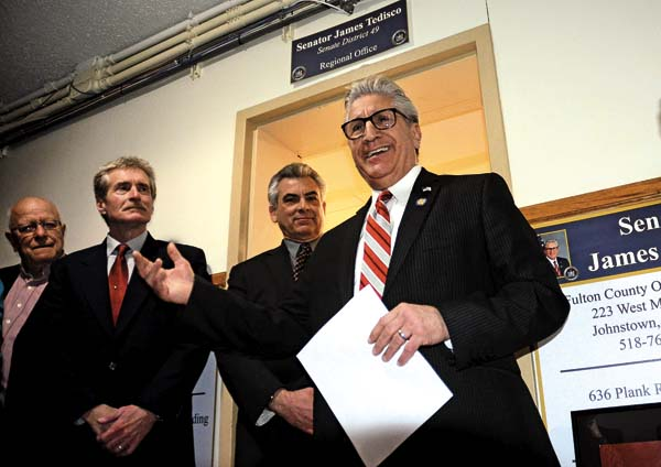 Sen. James Tedisco, right, makes a few remarks outside his new office in the basement of the Fulton County Office Building in Johnstown prior to a ribbon-cutting ceremony on Thursday. (The Leader-Herald/Bill Trojan)