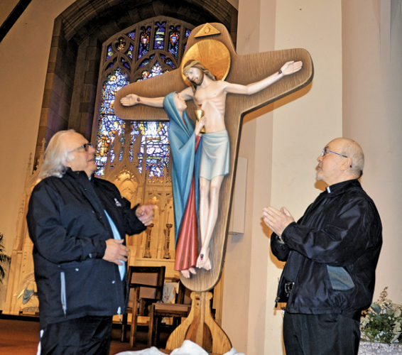 Fundraising chairman Joey Caruso, left, and Fr. Donald Czelusniak take a close look at the New Divine Mercy Cross in the sanctuary of the Holy Spirit Catholic Church in Gloversville on Thursday. The blessing of the cross will take place Saturday at a 4 p.m. Mass at the Church of the Holy Spirit.  Fr. Czelusniak will be the celebrant for the Mass. Gloversville's 4th Degree Knight Chris Hollenbeck and members of the Knights of Columbus will serve as the honor guards. The New Divine Mercy Cross was imported from Italy and is the first of its kind in the United States. (The Leader-Herald/Bill Trojan)