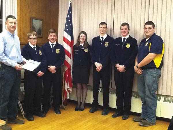 St. Johnsville village trustee Martin Callahan honors, from left, Mohawk Valley Future Farmers of America chapter members Connor Countryman, Liam Sammons, Laura Littrell, Casey Watston, Jacob Battisti and chapter adviser Chris Smith, with a proclamation for National FFA Week.  (Photo submitted)