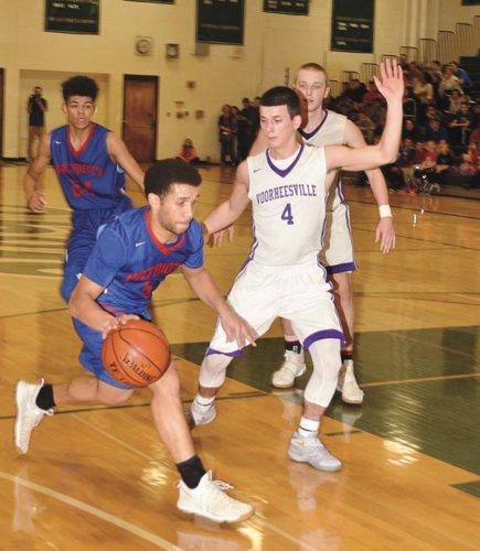 Broadalbin-Perth's Joey Ladipo (24) and Voorheesville's Sean Nolan look on as the Patriots' Preston Taylor works the ball against the Blackbirds' Cooper Smith during Section II Class B quarterfinal action Friday at Shenendehowa High School. (The Leader-Herald/James A. Ellis)