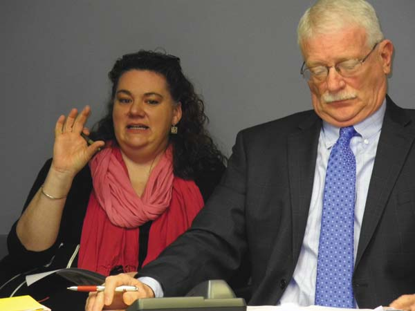 Jennifer Jennings, Gloversville downtown development specialist for the Fulton County Center for Regional Growth, left, discusses plans for events at the CRG board meeting Friday. At right is CRG President and CEO Ronald Peters.(The Leader-Herald/Michael Anich)