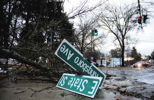 A top of a large tree was broken off and toppled onto the street sign at the corner of East State Street and North Kingsboro Avenue in Gloversville as a result of a fast-movinhg storm on Saturday.  (The Leader-Herald/Bill Trojan)