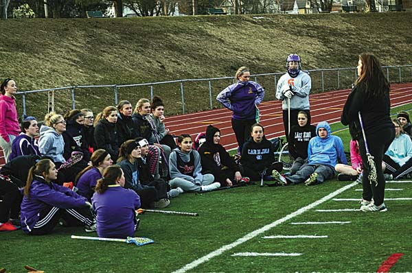 Coach Denise Benton, right, talks with members of the Johnstown Lady Bills lacrosse team on the opening day of practice Monday at Knox Field in Johnstown. (The Leader-Herald/James A. Ellis