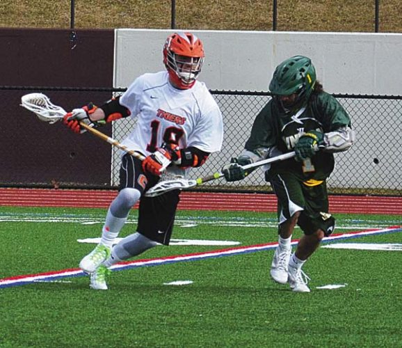"SUNY Cobleskill's Anthony Yevoli, left, controls the ball during a men's lacrosse game against Lyndon State College at Frank Bailey Field on the campus on Union College in Schenectady on Feb. 26. Yevoli, an Amsterdam High School graduate, recently was named the ""2017 Boy of the Year"" by the Upstate New York/Vermont Leukemia and Lymphoma Society. (Photo submitted)"