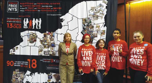 Cierra Mason, Veronica Shults, Erin Quigley, Samuel Cruz and Aislynn Ward, all Fulton County residents, pose in front of a map of the state that depicts the type of tobacco and point-of-sale marketing youth are exposed to across the state. (Photo submitted)