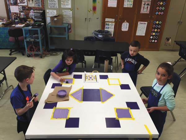 Pictured from left are Cashton Dalmata, Maddy Kraemer, Andrew Ramirez and Malania Sepanara working on a barn quilt as part of a class project at Glebe Street Elementary. (Photo submitted)