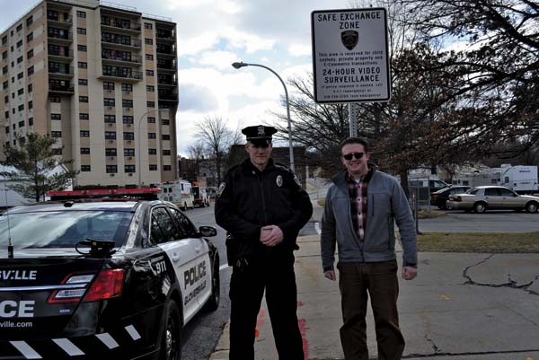 Gloversville Police Officer Wayne Hulslander Jr., left, and Mayor Dayton King stand in front of the new Safe Exchange Zone sign in front of Gloversville City Hall on Friday. (The Leader-Herald/Kerry Minor)